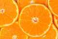 Orange background closeup with slices Royalty Free Stock Photos