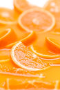 Orange background fruit slices in juice macro Royalty Free Stock Photos