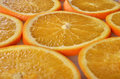 Orange background sliced ​​orange close up Royalty Free Stock Image