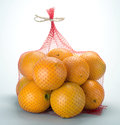 Orange bag of oranges on white background Royalty Free Stock Images