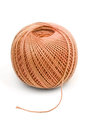 Orange ball clew of rope mauve wool curled into a on a white background Stock Images