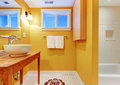 Orange bathroom with modern sink. Stock Photography