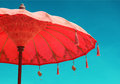Orange beach umbrella umbrella on sky background, vintage retro Royalty Free Stock Photo