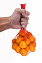 Orange being held by left hand Royalty Free Stock Image