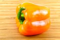 Orange bell pepper on wood Royalty Free Stock Photos