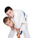 With orange belt athlete doing throw athlete with a blue belt Royalty Free Stock Photo