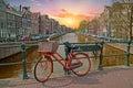 Orange bike in Amsterdam city center in the Netherlands Royalty Free Stock Photo