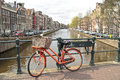 Orange bike in Amsterdam city in the Netherlands Stock Photos