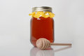 Orange blossom honey a mason jar of fresh with a wood drizzler Royalty Free Stock Photos