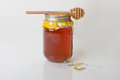Orange blossom honey a mason jar of fresh with a wood drizzler on top dripping with Royalty Free Stock Photos