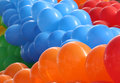 Orange, blue and red balloons Royalty Free Stock Photo