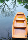 Orange boat little in a corner of the lake deadwood Royalty Free Stock Photography