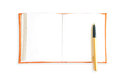 Orange book isolated Royalty Free Stock Photo