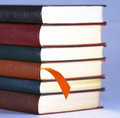 An Orange Bookmark and Leather Bound Books Royalty Free Stock Photo