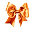 Orange bow made from silk ribbon isolated Stock Photos