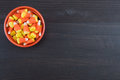 Orange Bowl of Candy Corn on Dark Background Royalty Free Stock Photo