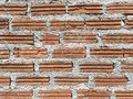 Orange brick and concrete wall backgound Royalty Free Stock Photo