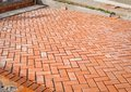 Orange brick paving stones in construction process Royalty Free Stock Photo