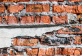 Orange brick wall, ruined part of a building, old texture Royalty Free Stock Photo