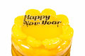 Orange cake with golden happy new year text Stock Image