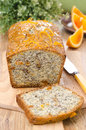Orange cake with poppy seeds dried apricots and walnuts on a wooden board Stock Images