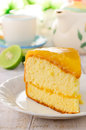 Orange cake on the white table Stock Photo