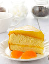 Orange cake on the white table Stock Photography