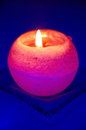 Orange candle on blue background Stock Photography
