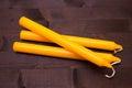 Orange candles on wood Royalty Free Stock Photo