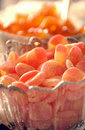 Orange candy in dish. Royalty Free Stock Photo