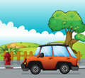 Orange car on a road and fire hydrant illustration of Royalty Free Stock Photography