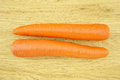 Orange carrot wood background is vegetable with carotene put on Stock Photos