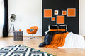 Orange chair in retro bedroom Royalty Free Stock Photo