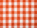 Orange checked kitchen towel texture close up Stock Photo