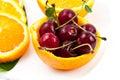 Orange with cherry closeup Stock Images
