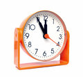 Orange clock retro shows five minutes to twelve Stock Photography