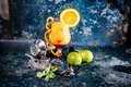 Orange cocktail with lime and vodka. Beverage alcoholic drink with lime, lemons and ice served cold at restaurant Royalty Free Stock Photo