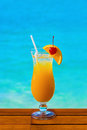 Orange cocktail on table sea background Stock Photography