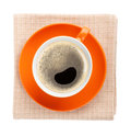 Orange coffee cup over kitchen towel view from above isolated on white background Royalty Free Stock Photo