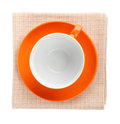 Orange coffee cup over kitchen towel view from above isolated on white background Royalty Free Stock Image