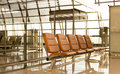 Orange color chair in airport waiting room Royalty Free Stock Photo