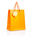 Orange colored paper bag white background Royalty Free Stock Image