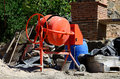 Orange concrete mixer cement at a construction work Royalty Free Stock Image
