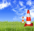 Orange cone on the lawn Royalty Free Stock Photography