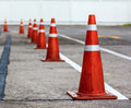 Orange cones direct traffic Royalty Free Stock Photo