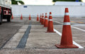 Orange cones direct traffic set up to Stock Photos