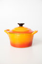Orange cooking pot with lid Royalty Free Stock Images
