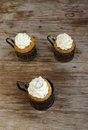 Orange Crown Muffins into the silver glass-holder Royalty Free Stock Photo