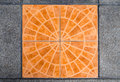 Orange decor tile and grey mortar floor
