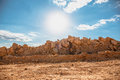 Orange desert sand stones and bright blue cloudy sky. Hipster retro toned landscape Royalty Free Stock Photo